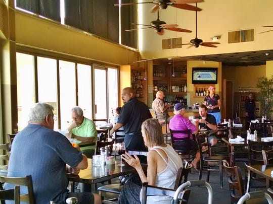 Contributing to the bistro vibe are warm colors and cafe-style tables.