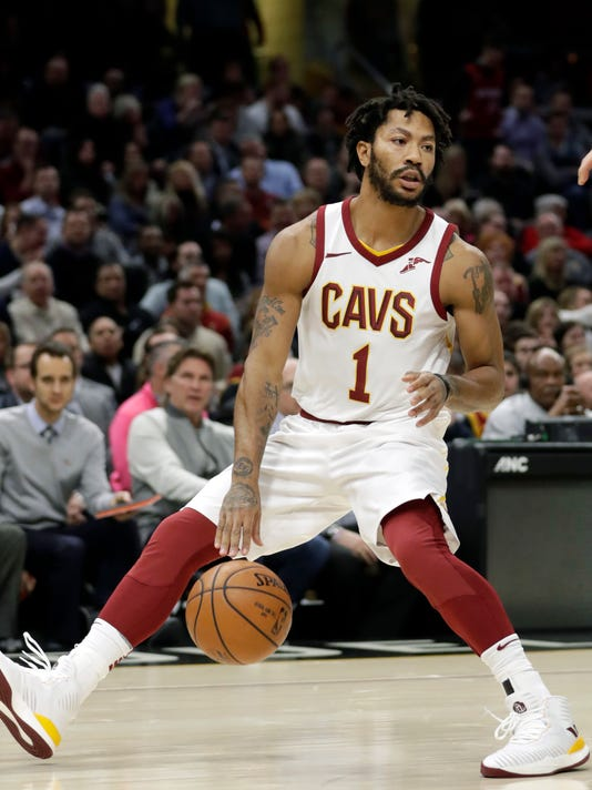 FILE - In this Jan. 31, 2018, file photo, Cleveland Cavaliers' Derrick Rose (1) drives against the Miami Heat in the first half of an NBA basketball game, in Cleveland.   The Cavaliers sent guard Derrick Rose and forward Jae Crowder to the Utah Jazz for forward Rodney Hood, Thursday, Feb. 8, 2018. (AP Photo/Tony Dejak, File)