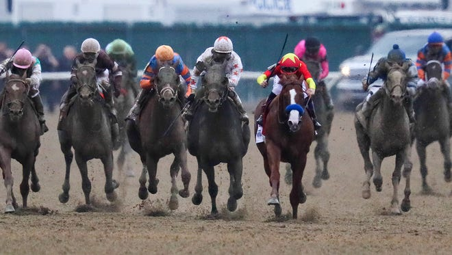 Justify with jockey Mike Smith win the Belmont Stakes and the Triple Crown of horse racing. June 09, 2018