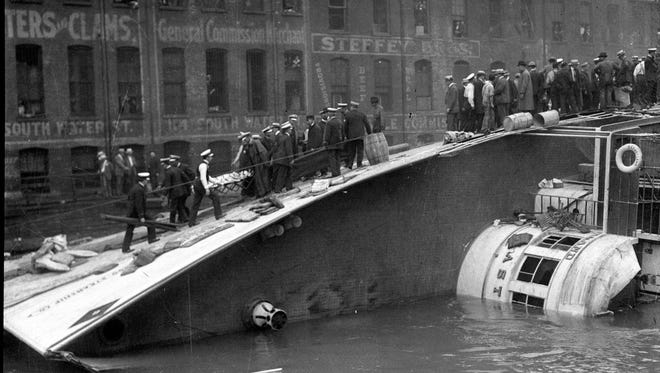 The S.S. Eastland lies on its side in the Chicago River after slowly rolling over on July 24, 1915; 844 people drowned.