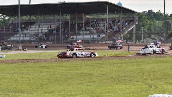 "Race cars take the track in late June at Thunderhill Raceway in Sturgeon Bay in front of a sparse crowd. The Door County Airport and Parks Committee and longtime track promoter Bryan ""Woody"" Wodack are exploring options to keep racing alive at Thunderhill."