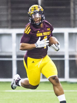 Arizona State University running back Demario Richard carries the ball during practice at the Dickey Dome on campus, Thursday, August 6, 2015.