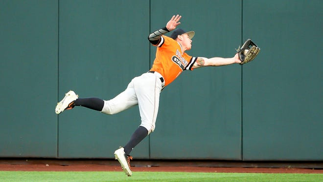 Oklahoma State Cowboys outfielder Ryan Sluder (8) makes a catch against the Arizona Wildcats in the first inning  in the 2016 College World Series at TD Ameritrade Park.