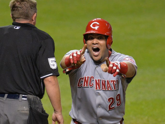 Cincinnati Reds catcher Brayan Pena (29) reacts after being tagged out at home plate in the ninth inning against the Cleveland Indians at Progressive Field.