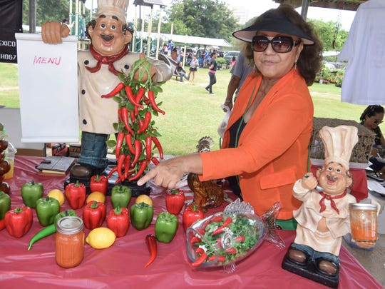 Dorothy Flores Borja shows off her last jar of dinanche at the Donne Festival held in Mangilao on Sept. 13, 2014.