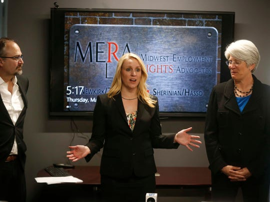 Jill Zwagerman, attorney for former University of Iowa senior associate athletic director Jane Meyer, at right, discusses their satisfaction after a Polk County jury awarded Meyer a victory in her sexual discrimination lawsuit against the University.