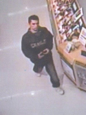 The male suspect is pictured at Wal-Mart.