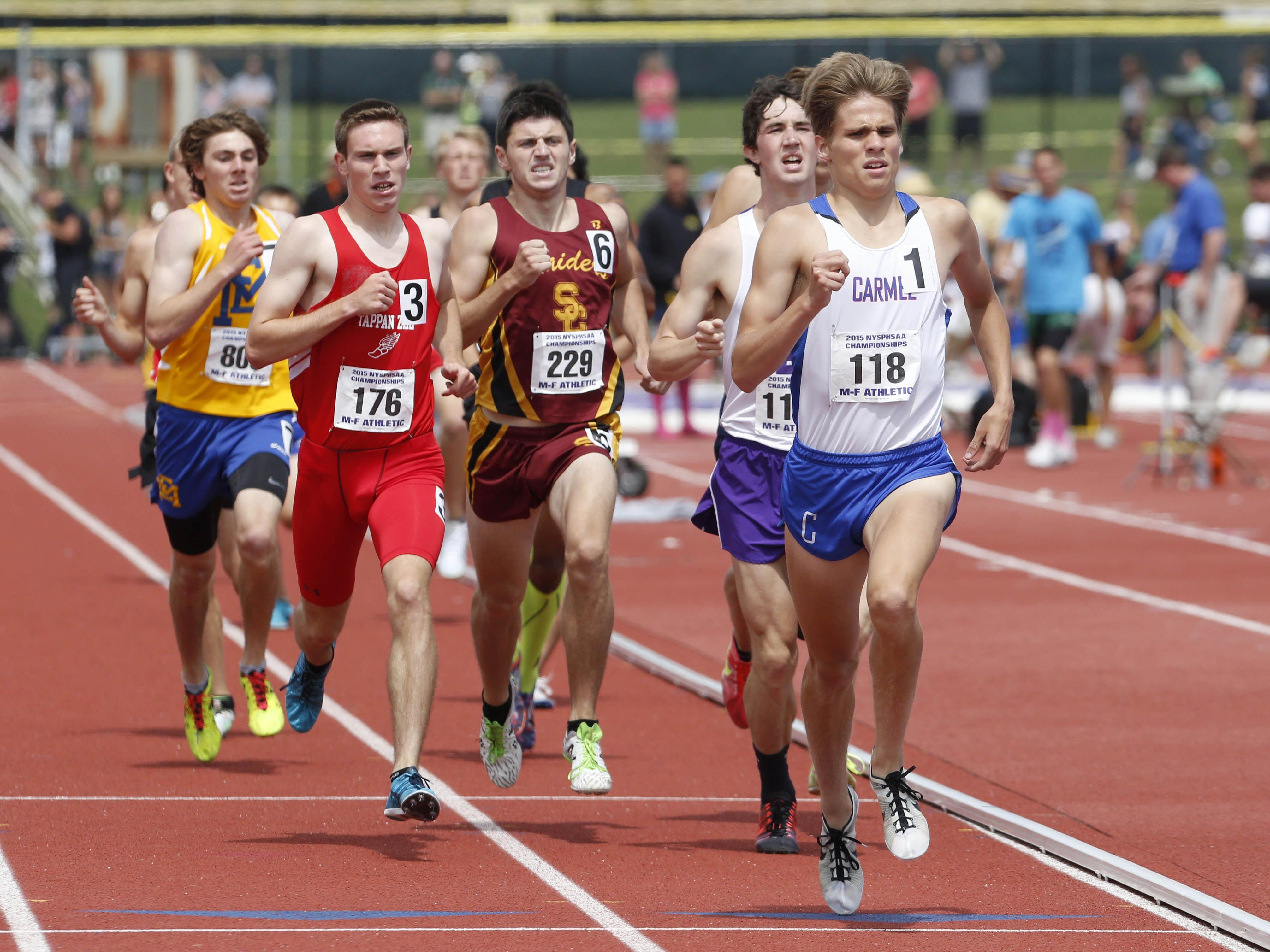 Tappan Zee's Luke Gavigan and Carmel's Benito Muniz competes in the 1600 meter run at the state track and field championships at the University at Albany, June 13, 2015.