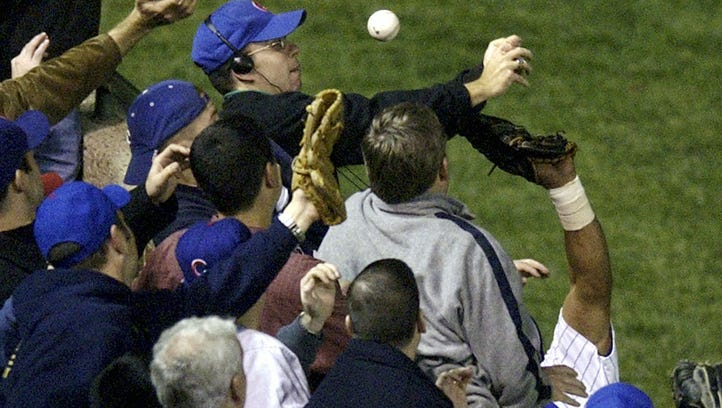 Cubs fan Steve Bartman interferes with a foul ball