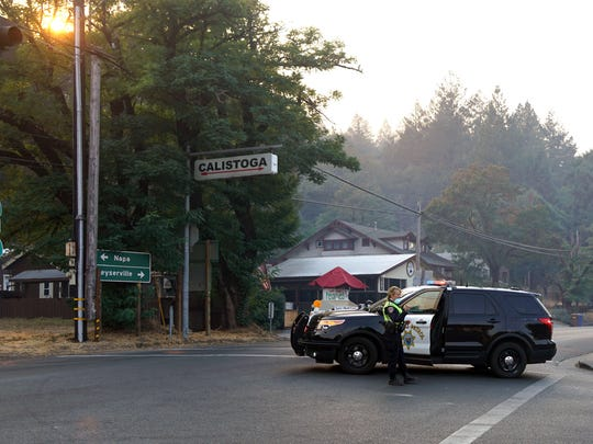 A California Highway Patrol officer guards the main
