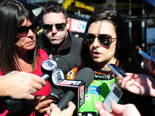 NASCAR Sprint Cup Series driver Danica Patrick (10) talks to the media after blowing an engine during practice for the Daytona 500 at Daytona International Speedway.