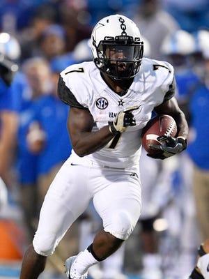 "Vanderbilt running back Ralph Webb (7) gains yards during the first half of an NCAA college football game at Johnny ""Red"" Floyd Stadium in Murfreesboro, Tenn., Saturday, Sept. 2, 2017."