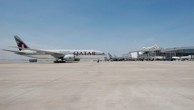 A Qatar Airways 777-200 airplane lands at Dallas-Fort Worth International Airport for the first time.