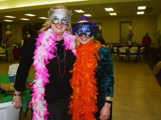 Diana Edge and Michelle Meek show off their Mardi Gras
