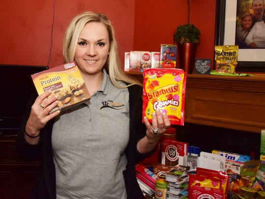 Chiropractic assistant Laren Vittetoe with soldier favorites, granola bars and Gummies.