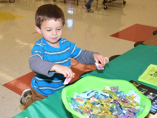Desmond Waddell, 3, helps himself to the candy dish.