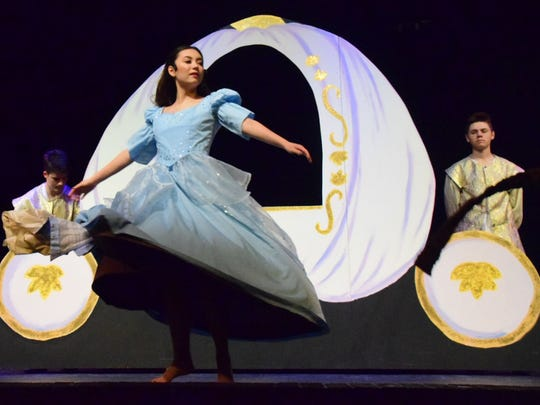 Olivia Asano as Cinderella provides a pivotal moment in the play by revealing her ball gown in a series of twirls.