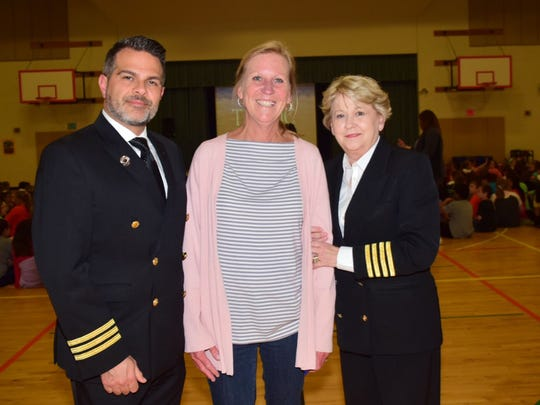 Chris Massie, executive director of the Titanic Museum, Sharon Yarbrough, principal of Amherst Elementary, and Mary Kellogg, co-owner of the Titanic Museum, take a pause during Brynjar Karl's visit to Amherst Elementary School.