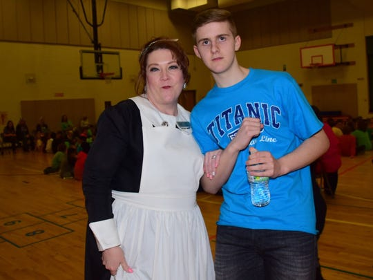 Jodi Justus from the Titanic Museum, dressed as a first-class maid, and Brynjar Karl traveled to 10 East Tennessee schools presenting a slide show of Karl's experience building a 26-foot LEGO model of the Titanic.