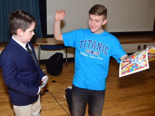 Aiden Wertheimer, 9, and Brynjar Karl, both on the autism spectrum, talk about their respective special skills during Karl's visit to Amherst Elementary to talk about his LEGO Titanic model Wednesday, April 18. Karl explained that everyone has an X factor that makes them special. Aiden showed off his X factor, reciting all the presidents in order.
