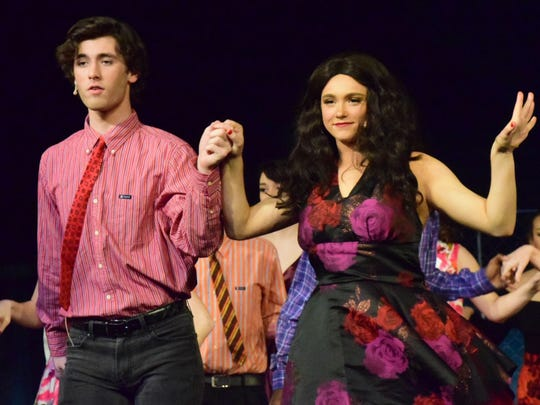 Bernardo (Cole Lawrence) and Anita (Grace Warnock) dance to a Latin tune during one of the many sweeping dance scenes.