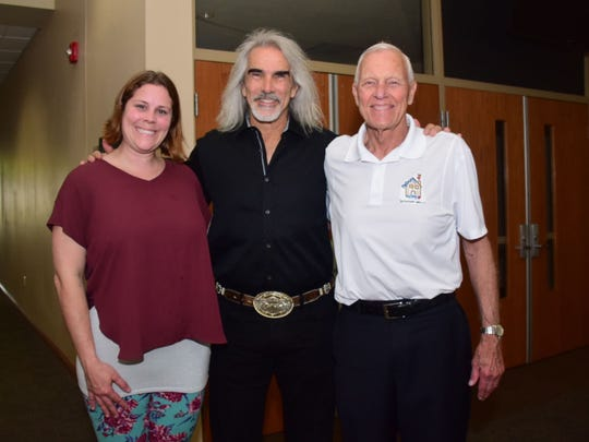 Chante Hensley with Bethany Christian Services, a foster-to-adoption agency, Christian singer Guy Penrod, and Fostering Hope Tennessee president Allen McMichael take a pause before a benefit concert at Fellowship Church Friday, May 3.