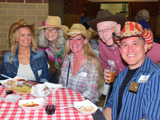 Treasa Valente, Eleanor Kulikowski, Dawn Balboa, Cy Henke, and Robert Valente seem to be enjoying the Western theme along with the downhome BBQ at the annual All Saints Catholic Church Adult Social held at Knoxville Catholic High School on Friday, May 11.
