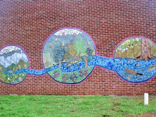 Designed by Knoxville artist Jillian Hirsch and installed at Karns Senior Center, the 25-foot-by-6-foot mosaic mural depicting Beaver Creek running through buffer plants along with a streamside beaver was officially opened to the public Tuesday, July 17.