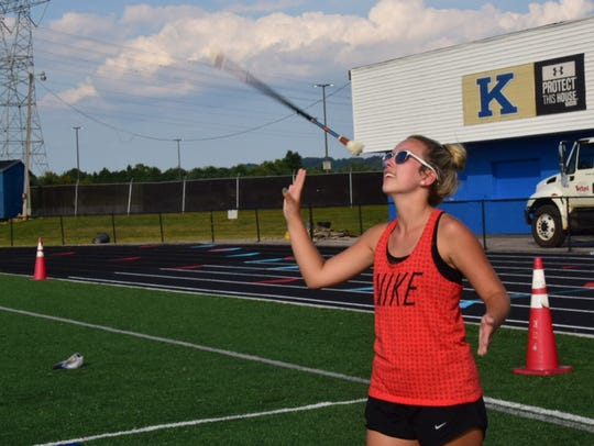 Kaylee Kennedy, 19, tosses her baton and catches it