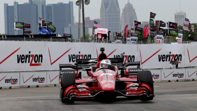 Graham Rahal, with Rahal Letterman Lanigan Racing, rounds turn two with the Detroit skyline in the background during the first practice at the 2015 Chevrolet Detroit Belle Isle Grand Prix on Friday, May 29, 2015.