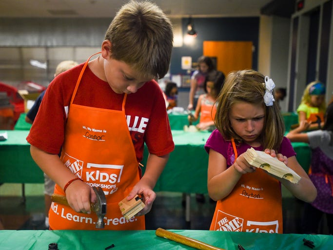 Connor and Payton Jacquot work on their model cars during B.A.S.E. Camp's after-school Heat Days Extended Care at Bacon Elementary, Friday August 22, 2014. Home Depot has partnered up with many schools in the area to provide do-it-yourself courses for the kids.