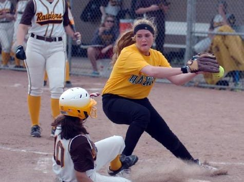 Sophomore pitcher Nora Battersby covers the plate during a game with North Farmington last year.