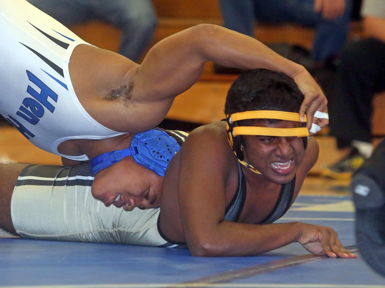 Pearl River's Dan Hogan, left, pinned Croton's Izzy Rocker in a 170 lbs. bout during a quad wrestling meet at Hendrick Hudson High School Dec. 3, 2015.