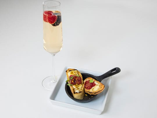The fruit in lingonberry Brie crostini joins with the fruit in a Matin en Provence sparkler.
