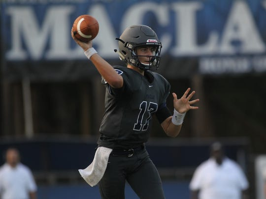 Maclay quarterback Brecht Heuchan rolls out for a pass.