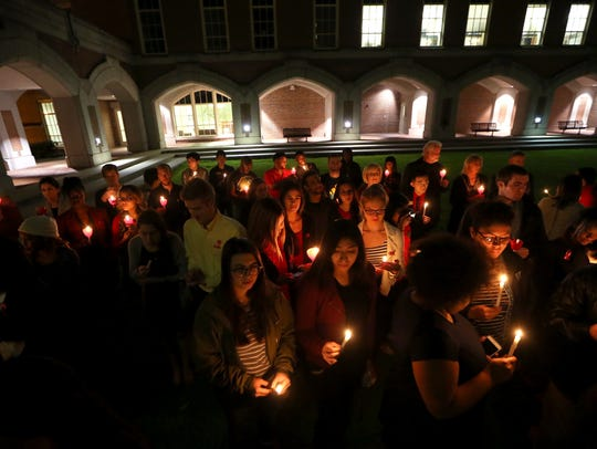 Students share in a moment of silence during Florida