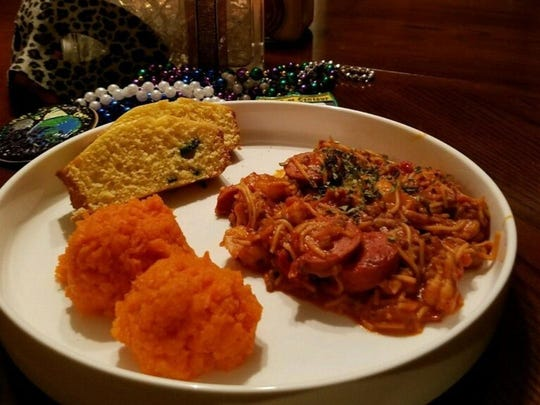 Creole Spaghetti with a side of mashed carrots and jalapeno cornbread prepared by William Pierre Davis of Man in an Apron Catering.