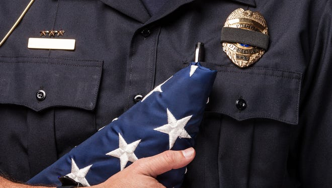 Mourning the death of a fellow officer.