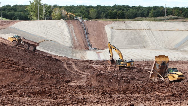 Construction workers build a new cell for industrial waste at the Red Hills Landfill in Kaukauna.