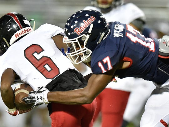 Ryan senior defensive back Rondarius McGarr (17) tackles Wichita Falls High School junior wide receiver A.J. Byrd (6) at C.H. Collins Athletic Complex, Thursday, October 26, 2017.