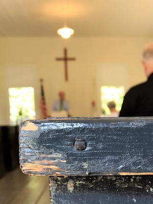 Old hand-hewn pews and hand-made nails are part of Providence Methodist Church, built in 1860.