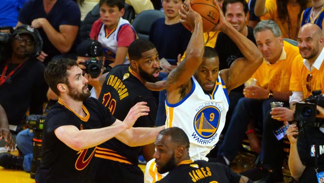 Golden State Warriors forward Andre Iguodala (9) handles the ball against Cleveland Cavaliers forward LeBron James (23) during the third quarter in game five of the 2017 NBA Finals at Oracle Arena.