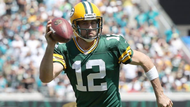 Aaron Rodgers is battling calf and hamstring injuries as the Packers head into Week 15.