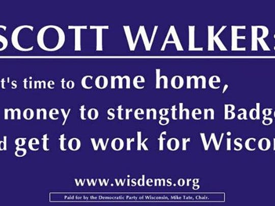 Wisconsin Democrats put up billboards like this in Green Bay and Milwaukee.