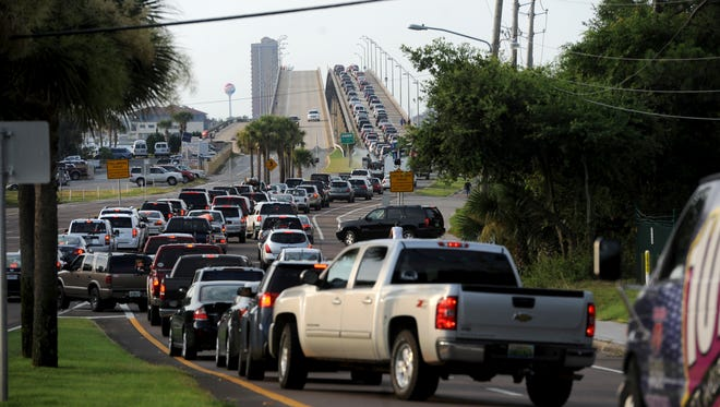 Drivers wait in line to get over to Pensacola Beach.