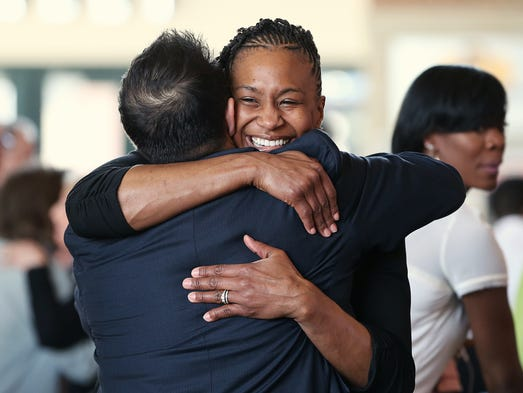 Indiana Fever's Tamika Catchings greets guests during