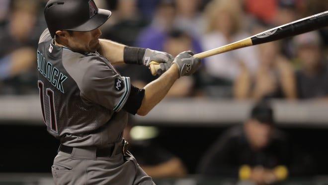 The Diamondbacks' A.J. Pollock follows through on a two-run home run off Colorado Rockies relief pitcher Jordan Lyles during the sixth inning in Denver on Sept. 2, 2016.