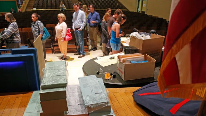 Voting ballots are stacked and ready as voters wait in line to cast their ballot in Milwaukee in June 2012.