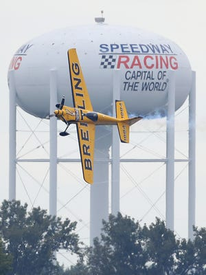 Pilot Francois Le Vot, of Breitling Racing Team, maneuvers the pylons during practice for the Red Bull Air Race Friday, October 1, 2016, afternoon at the Indianapolis Motor Speedway.