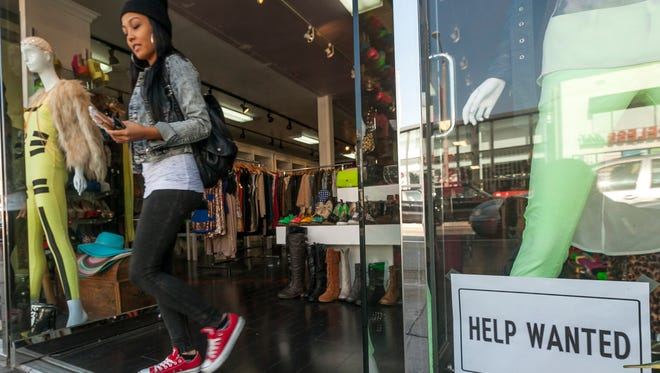 A help wanted sign is posted on the front window of a clothing boutique in Los Angeles.